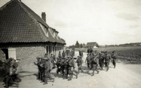 Photo: Merville, France. 1914, World War 1. Gurkhas marching out to dig trenches. Photographer: H. D. Girdwood.
