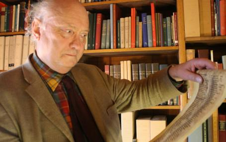 Prof. Nigel F. Palmer consulting the facsimile of the 'Osterspiel von Muri' in the Taylor Institution Library